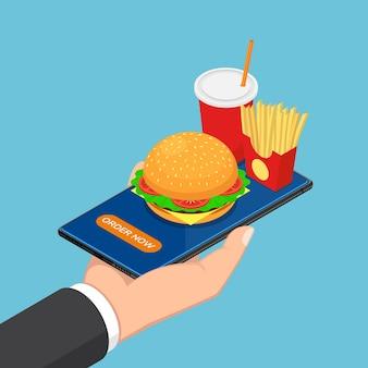 Piatto 3d isometrico uomo d'affari mano che tiene smartphone con fast food, hamburger, patatine fritte e una bevanda. concetto di consegna di cibo online.