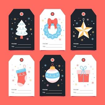Collezione piatta di etichette natalizie