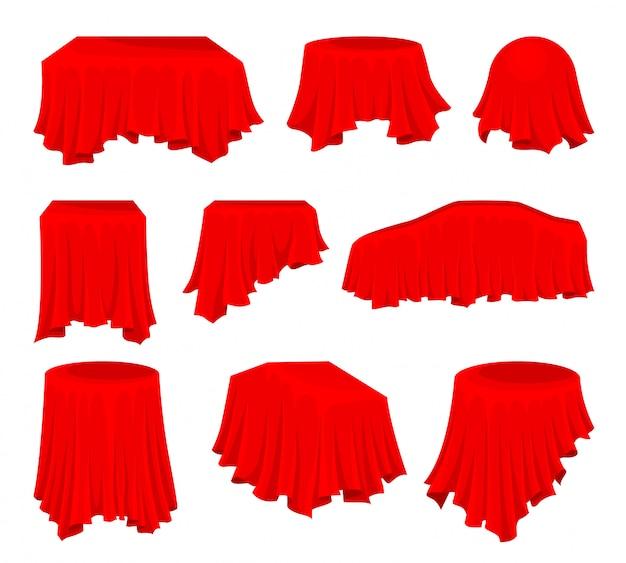 Set piatto di panno rosso brillante. tessuto di seta. materiale tessile. oggetto nascosto. biancheria da tavola. presentazione di auto