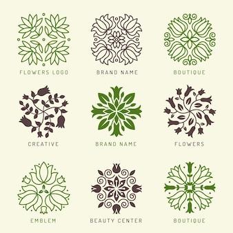 Logo floreale. botanico stilizzato elementi decorazione simboli foglie e fiori rami forme benessere spa cosmetico logo vettoriale