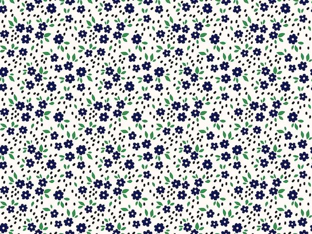 Motivo floreale. bei fiori, sfondo bianco. stampa con piccoli fiori blu navy. stampa ditsy