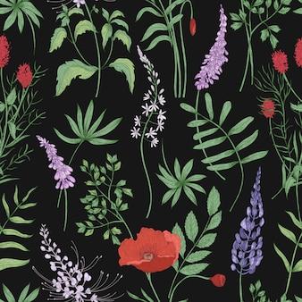 Motivo floreale senza soluzione di continuità con i fiori di prato in fiore sul nero