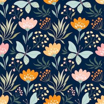 Motivo floreale senza soluzione di continuità con farfalle e fiori diversi