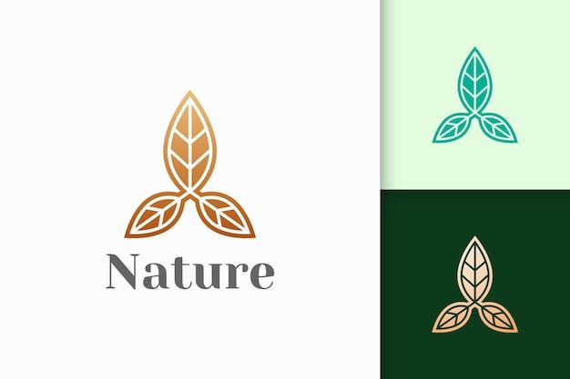 Logo del fiore a forma di tripla foglia per la salute e la bellezza