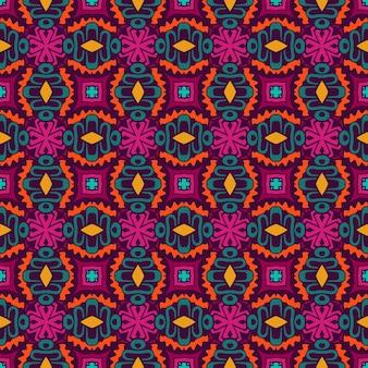 Piastrelle senza cuciture etniche di design retrò arte del fiore. modello piastrellato colorato festivo.