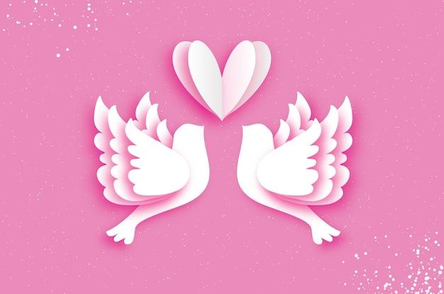 Flying love birds in carta tagliata stile. un paio di colombe innamorate.