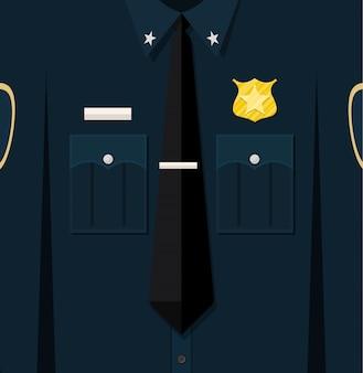 Uniforme da poliziotto blu ripiegata con stemma.