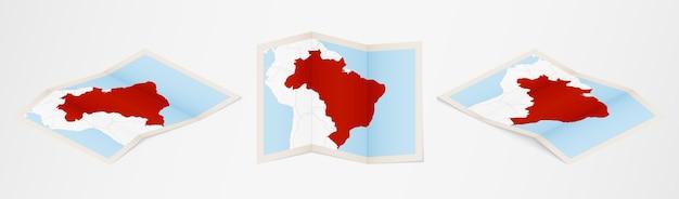 Mappa piegata del brasile in tre diverse versioni.