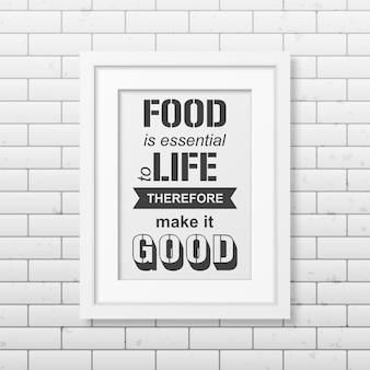 Il cibo è essenziale per la vita, quindi rendilo buono - citazione tipografica in una cornice bianca quadrata realistica sul muro di mattoni