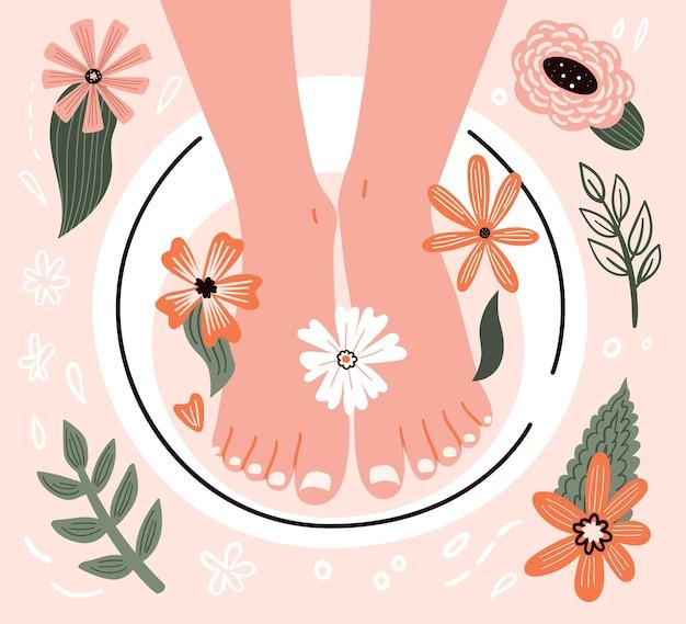 Maschera per i piedi con elementi floreali naturali salone di bellezza e pediluvio gambe femminili durante il massaggio