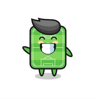 Personaggio dei cartoni animati del campo di calcio che fa il gesto della mano dell'onda, design in stile carino per maglietta, adesivo, elemento logo