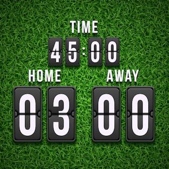 Tabellone segnapunti di calcio di calcio sul fondo dell'erba