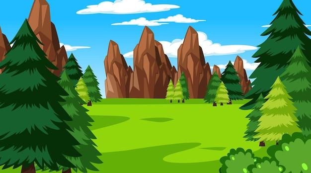 Scena della foresta con vari alberi della foresta e sfondo della scogliera