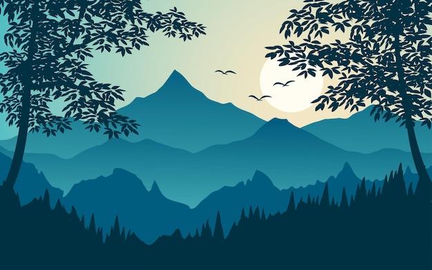 Paesaggio di tramonto della foresta in silhouette con la montagna
