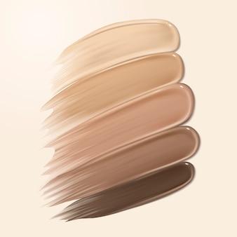 Texture cremosa di fondotinta, striscio di tonalità della pelle diversa