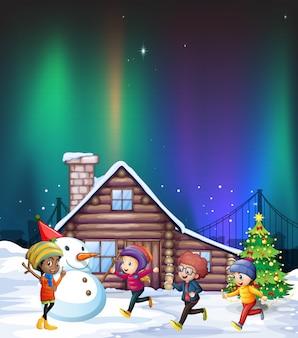 Quattro ragazzi che giocano con la neve durante la notte
