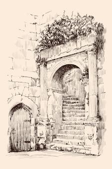 Frammento di edificio urbano in pietra con scala a chiocciola, arco e porta.