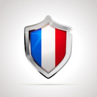 Bandiera della francia proiettata come uno scudo lucido