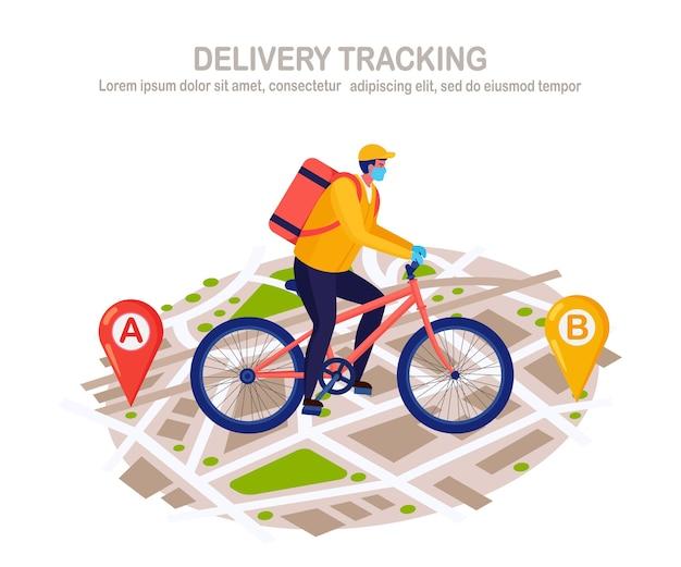 Servizio di consegna veloce gratuito in bicicletta. il corriere in una maschera per il respiratore consegna cibo