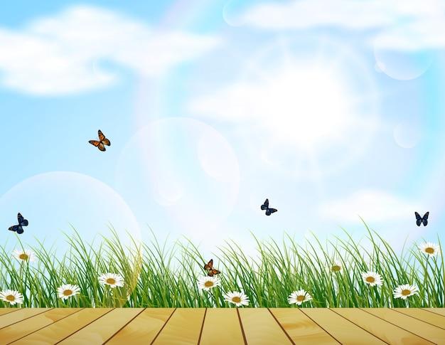 Campi di primavera fresca con fiori e farfalle