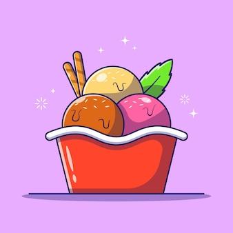 Gustose palline fresche di gelato scoop in una ciotola con rotoli di cialda e foglia di menta