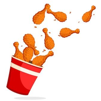 Le cosce di pollo fritte volarono fuori dal secchio su uno sfondo bianco. fast food.