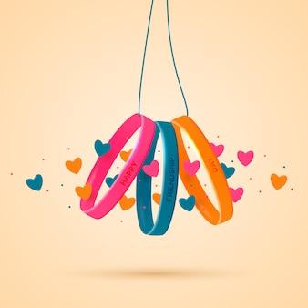 Giornata dell'amicizia. tre braccialetti in gomma siliconica con scritte di congratulazioni su una corda.