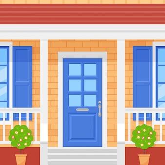 Casa della porta d'ingresso. portico di casa. facciata con muro di mattoni, porta blu, arte topiaria e finestre. design piatto. illustrazione del fumetto
