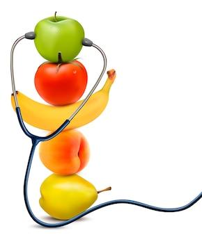 Frutta con uno stetoscopio. concetto di mangiare sano.
