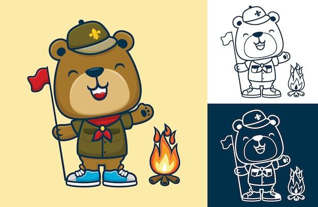 Fumetto divertente dell'orso in uniforme da scout mentre tiene la bandiera con il falò