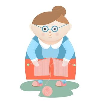 Nonna divertente con ferri da maglia e un gomitolo di lana.