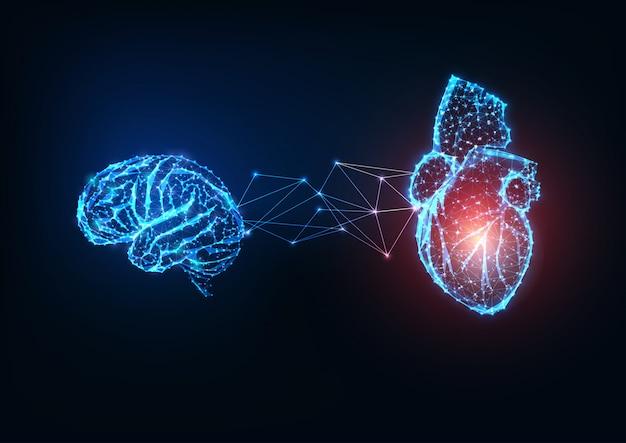 Cervello e cuore collegati poligonali bassi incandescenti futuristici degli organi su fondo blu scuro.