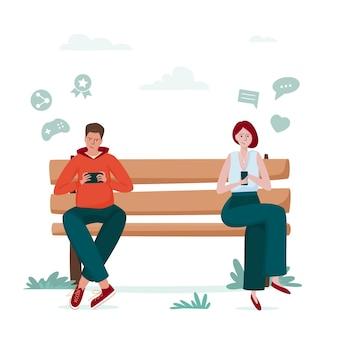 Dipendenza da gadget, uomo e donna in panchina dipendenti dagli smartphone.