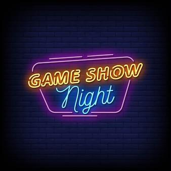 Insegna al neon di game show night sul muro di mattoni