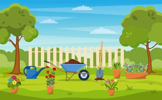 Giardino con prato verde, fiori, carriola da giardino, pala.