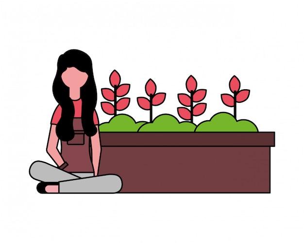 Donna giardiniere con piante in vaso