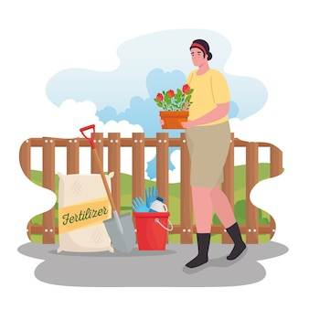 Donna di giardinaggio con la pala del sacchetto del fertilizzante dei fiori e la progettazione del secchio degli strumenti, la piantatura del giardino e la natura