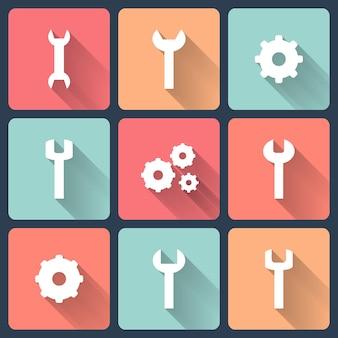 Set di icone piane dell'ingranaggio e della chiave inglese. illustrazione vettoriale