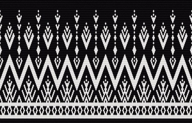 Ricamo a motivo etnico geometrico e design tradizionale. struttura etnica tribale. design per moquette, carta da parati, abbigliamento, involucro, batik, tessuto in stile ricamo in temi etnici.
