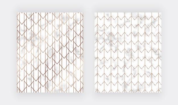 Linee dorate geometriche sulla trama di marmo.
