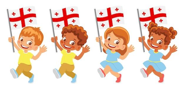 Bandiera della georgia in mano. bambini che tengono bandiera. bandiera nazionale della georgia
