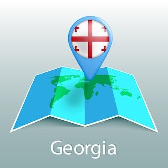 Mappa del mondo di bandiera della georgia nel pin con il nome del paese su sfondo grigio