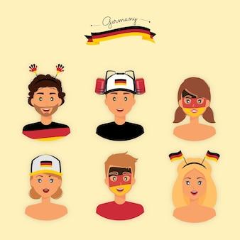 Tifosi tedeschi con accessori vernici e attrezzature per supportare la loro squadra di calcio