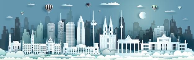 Punti di riferimento di viaggio di architettura della germania di berlino con palloncini e aeroplano, paesaggio urbano di giro con vista panoramica e capitale, stile taglio carta.