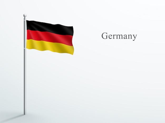 Elemento 3d di bandiera germania sventolando sul pennone in acciaio