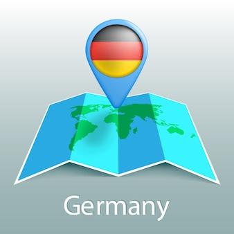 Mappa del mondo di bandiera germania nel pin con il nome del paese su sfondo grigio