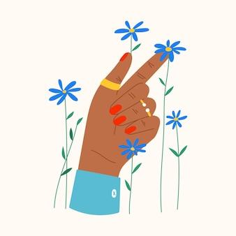 Gesto con fiori e foglie composizione piatta alla moda con fiore che tiene la mano