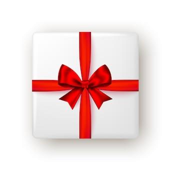 Confezione regalo con nastro rosso e fiocco, vista dall'alto