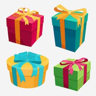 Set di scatole regalo con nastro rosso e fiocco.