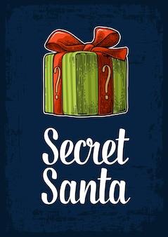 Scatola regalo verde scritta secret santa per l'incisione di buon natale e felice anno nuovo